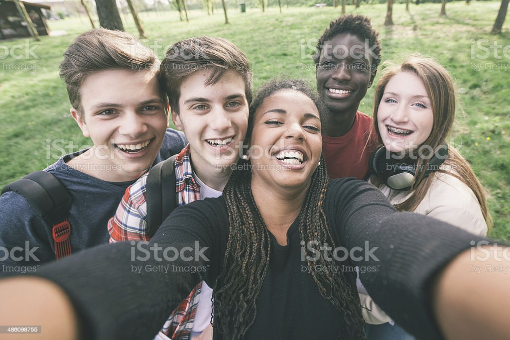 Group of Multiethnic Teenagers Taking a Selfie stock photo