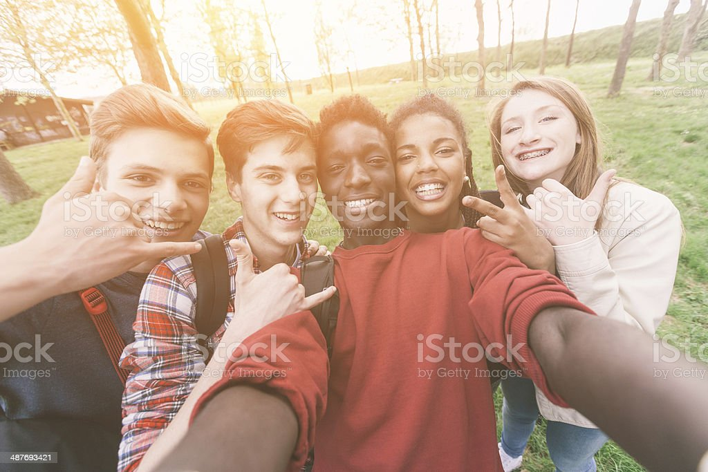 Group of multi-ethnic teenagers taking a selfie stock photo