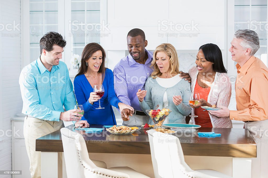 Group of multiracial adult friends having fun at a party stock photo