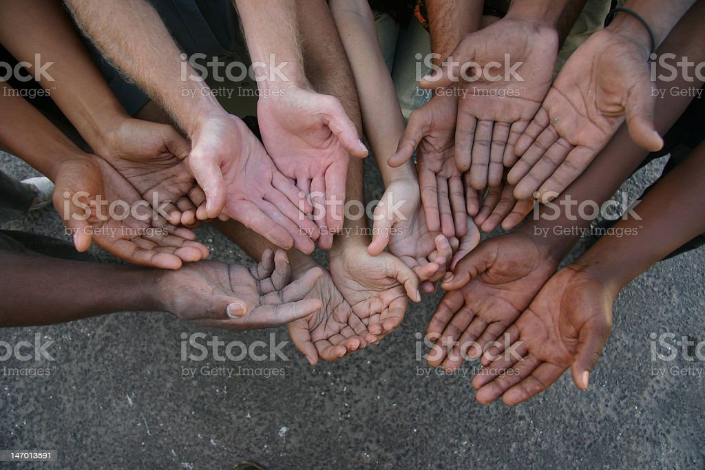 Group of multiracial hands palms up outside stock photo