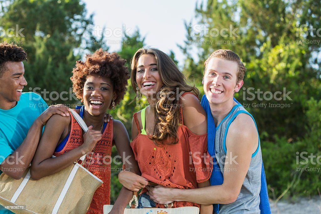 Group of multiracial young adults having fun in summer stock photo