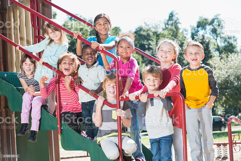 Group of multracial children on a playground stock photo