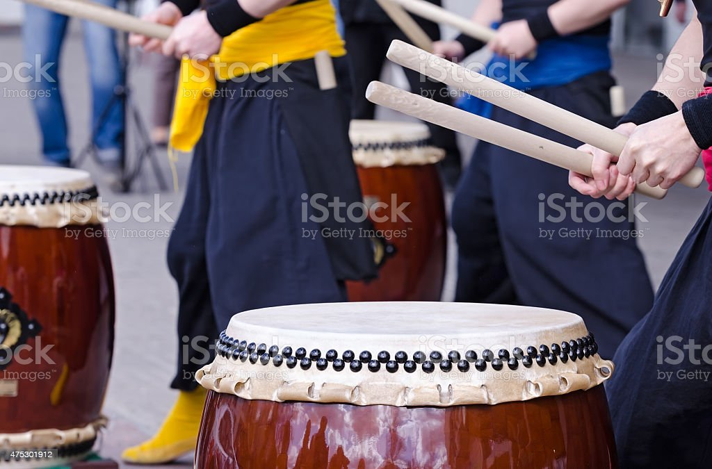 Group of musicians are playing on traditional japanese percussion instrument stock photo