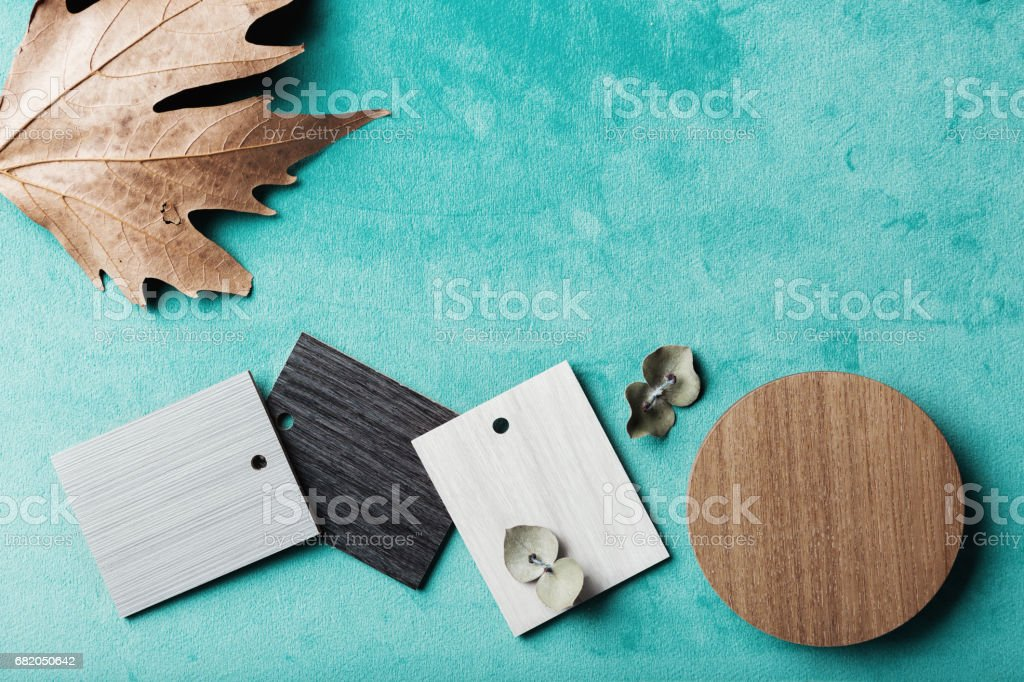 Group of muted wood and laminte swatches flat lay stock photo