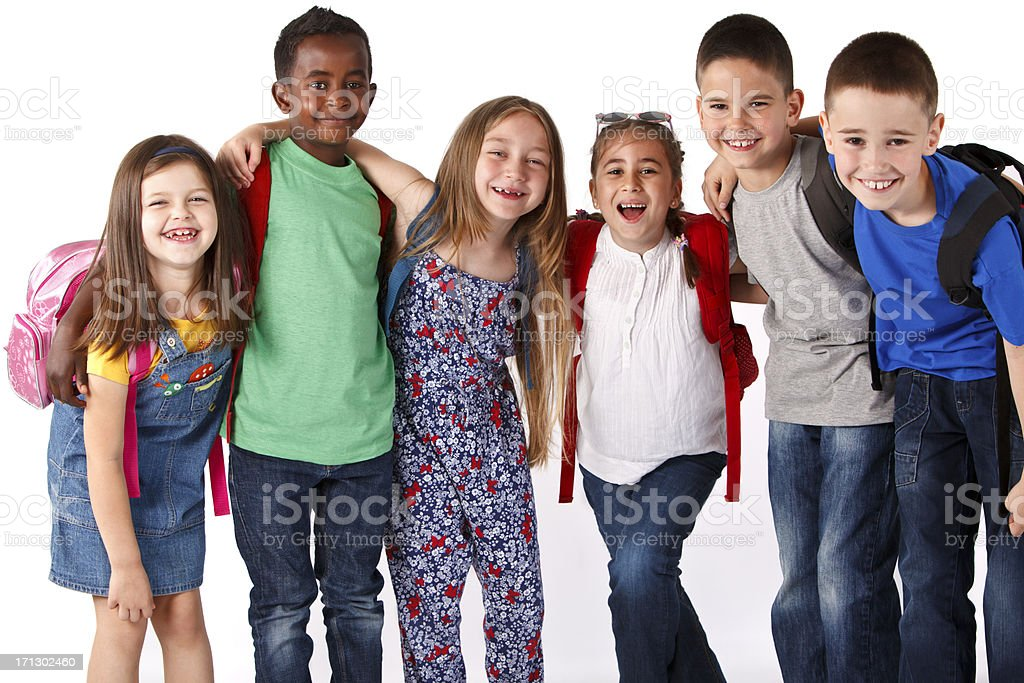 Group of mutli ethnic school children smiling and embracing royalty-free stock photo