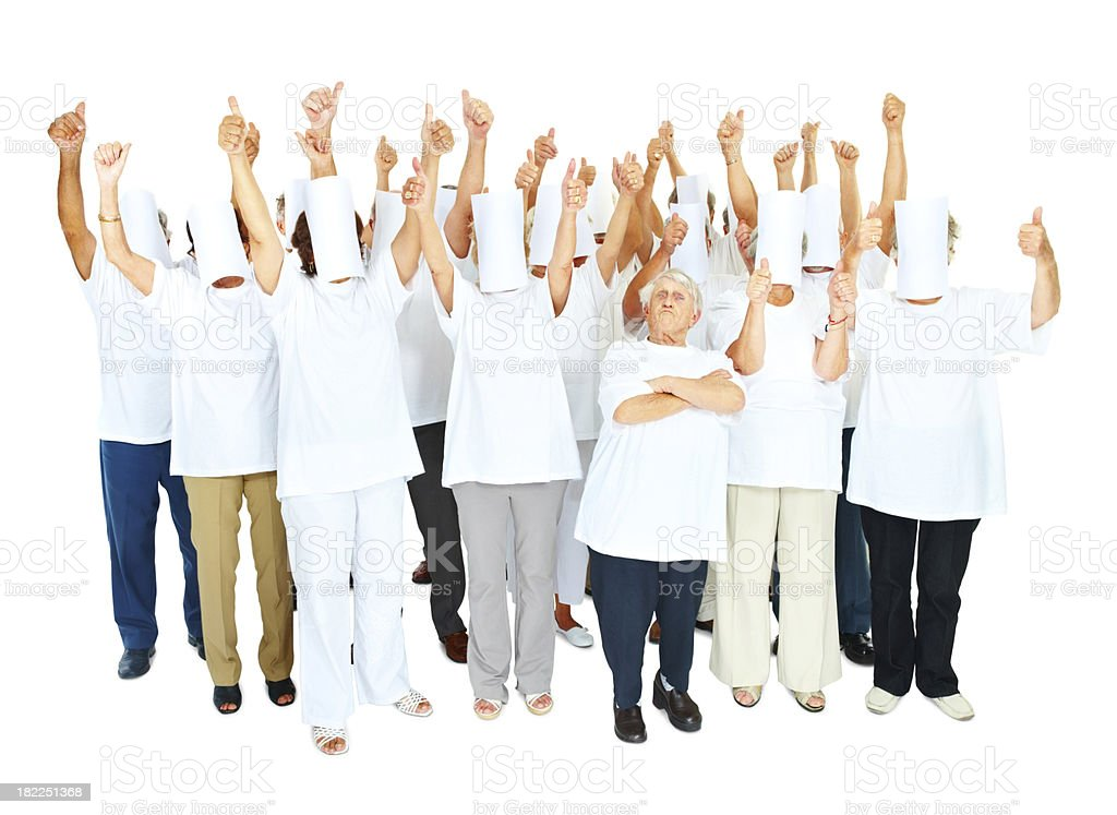 Group of obscured people with senior female leader royalty-free stock photo