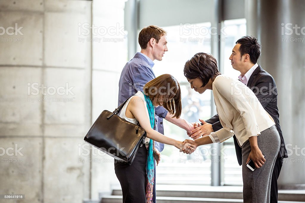 Group of office executives meeting after an event. stock photo