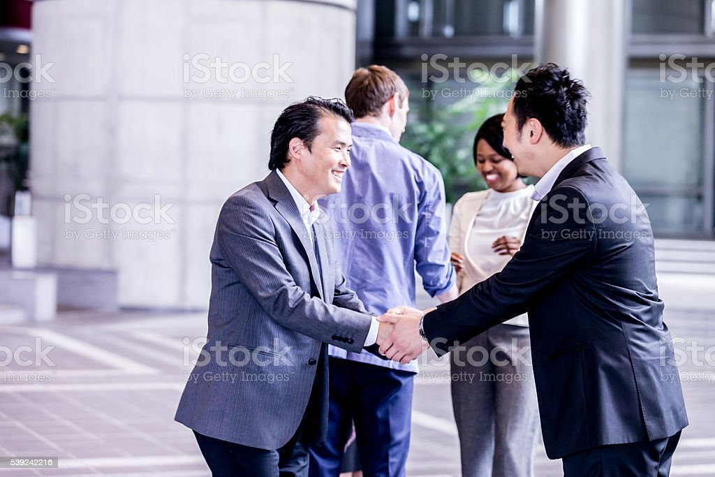 Group of office executives meeting before a corporate event stock photo
