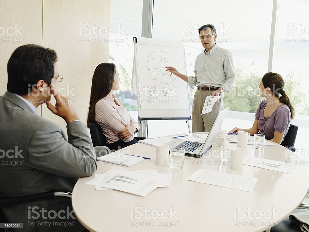 Group of office workers attending a presentation royalty-free stock photo