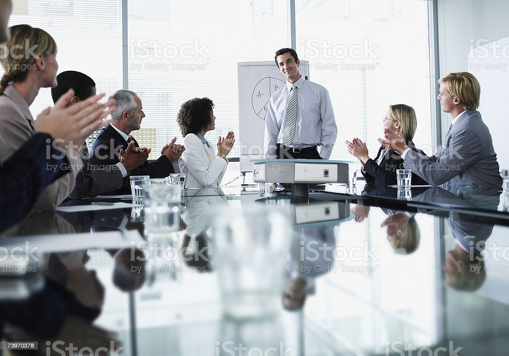Group of office workers in a boardroom presentation royalty-free stock photo