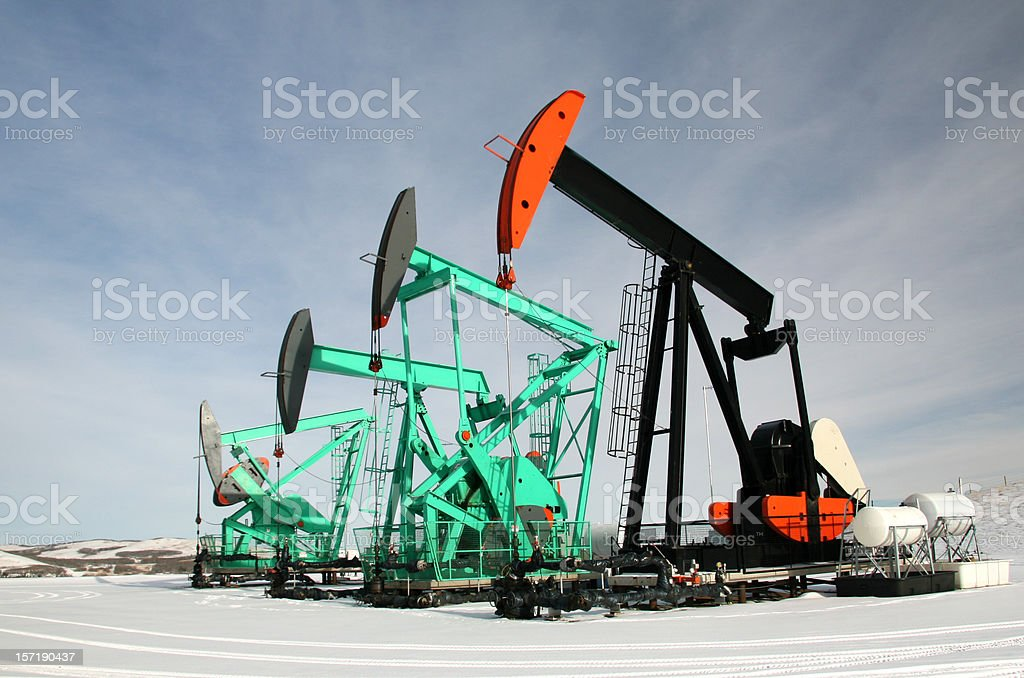 Group of Oil Rigs or Pumpjacks in Winter Alberta Oilfield royalty-free stock photo