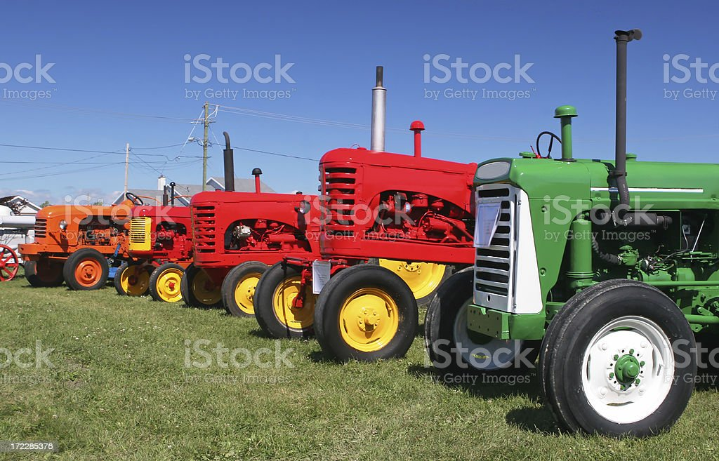 Group of Old farm tractors stock photo