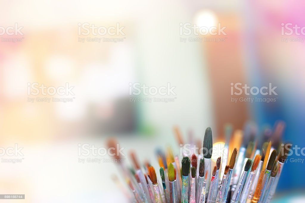 Group of old used paint brushes with clean background, stock photo