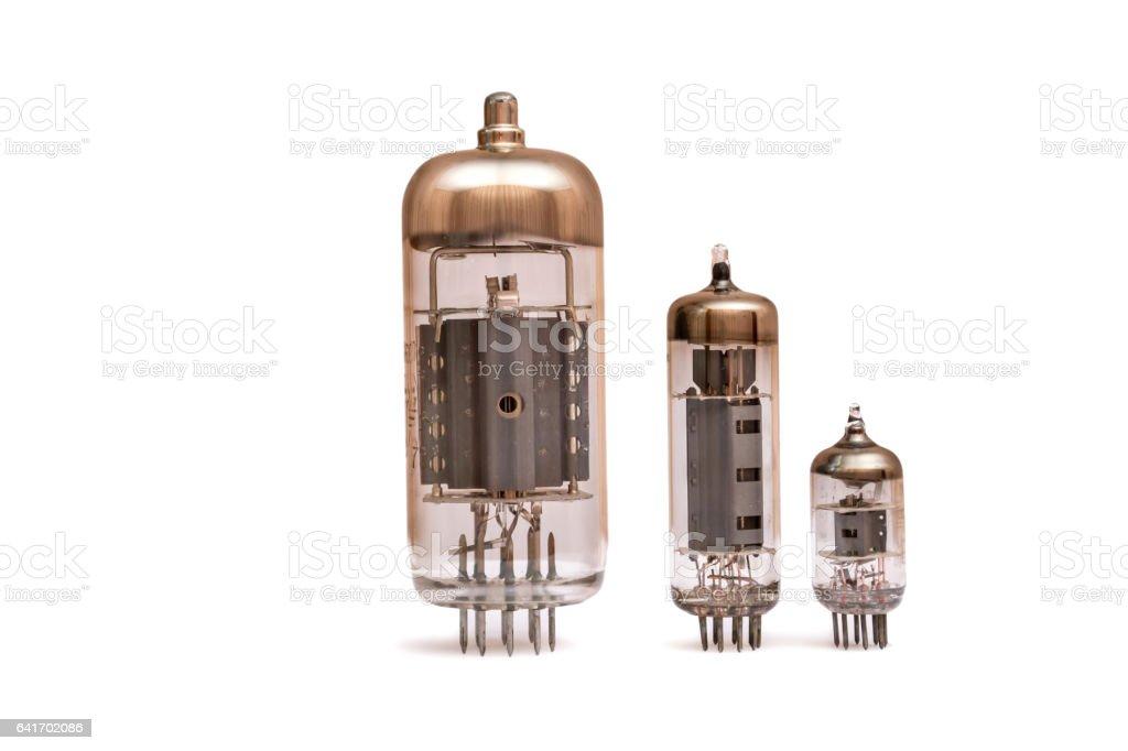 Group of old vacuum tubes isolated on the white background, radio valves. stock photo