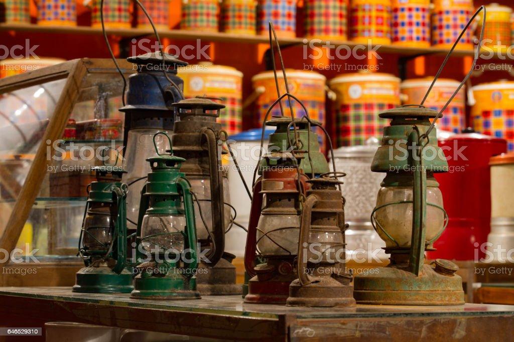 Group of old vintage storm lanterns hurricane lamp put on vintage cabinet wood stock photo