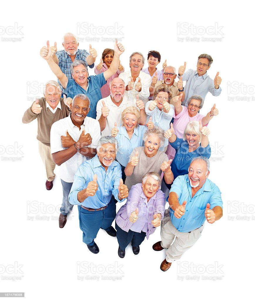 Group of older people smiling and with thumbs up royalty-free stock photo
