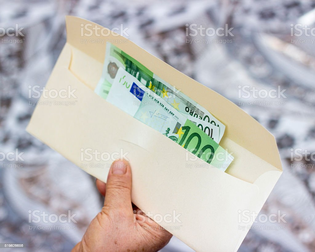 Group of one hundred euro banknotes in envelope stock photo