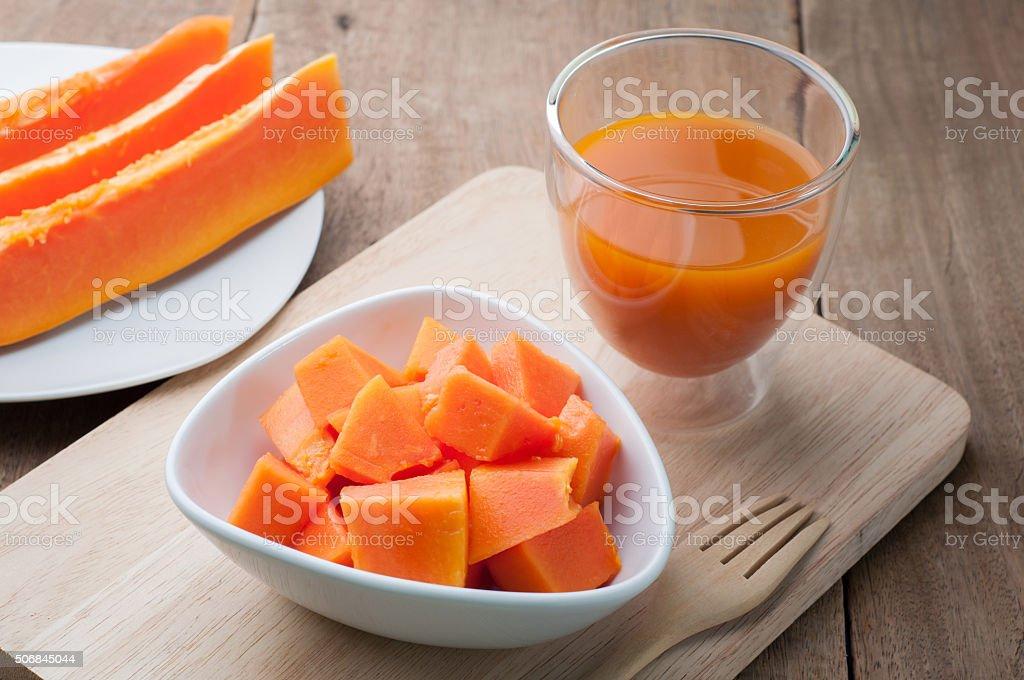 Group of orange papaya on white dish, papaya juice. stock photo
