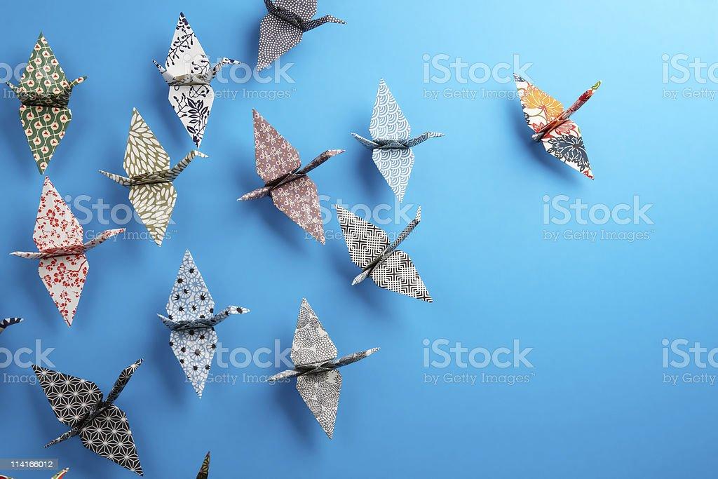 Group of origami birds stock photo