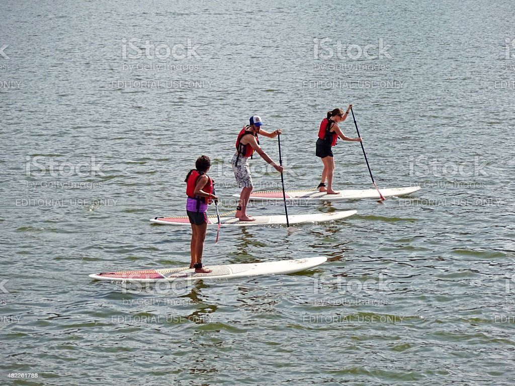 Group of Paddler Boarders stock photo