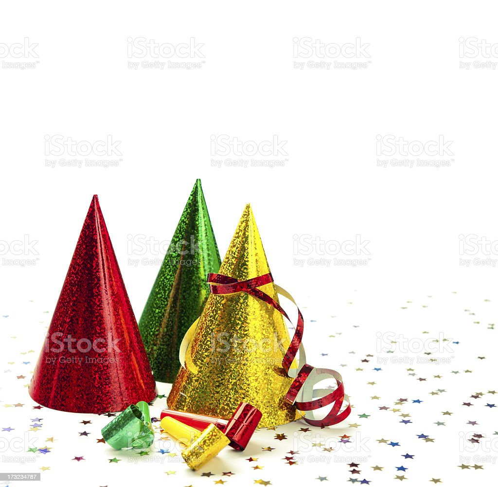 Group of party hats, whistles, streamers, confetti, isolated on white royalty-free stock photo