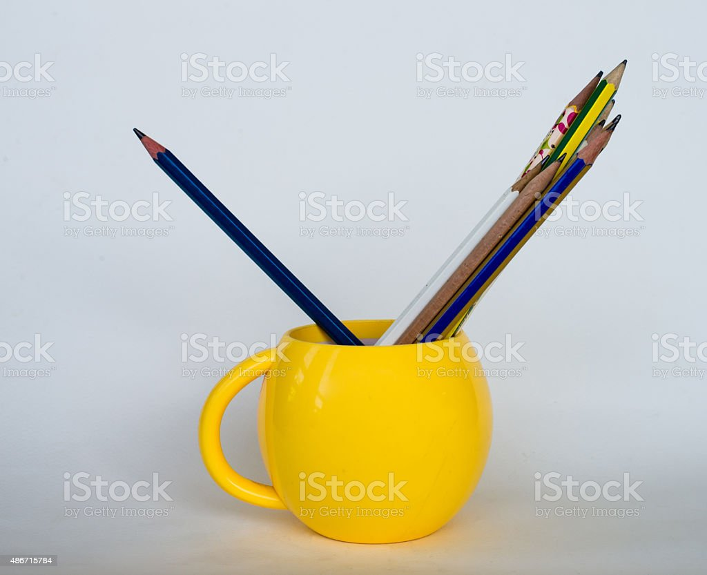 Group of pencils  in yellow cup. stock photo