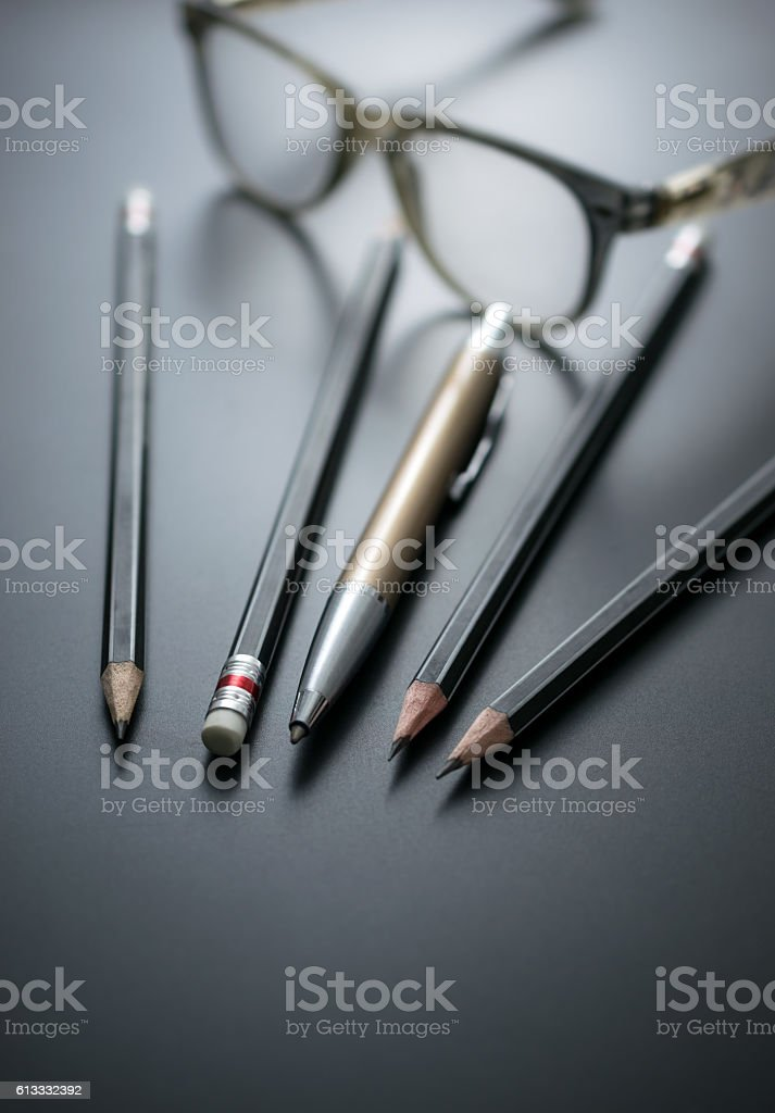 group of pencils on blackboard focus at pencil eraser, stock photo