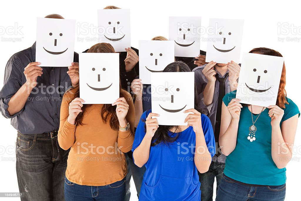 Group of People All Holding Smiley Faces stock photo