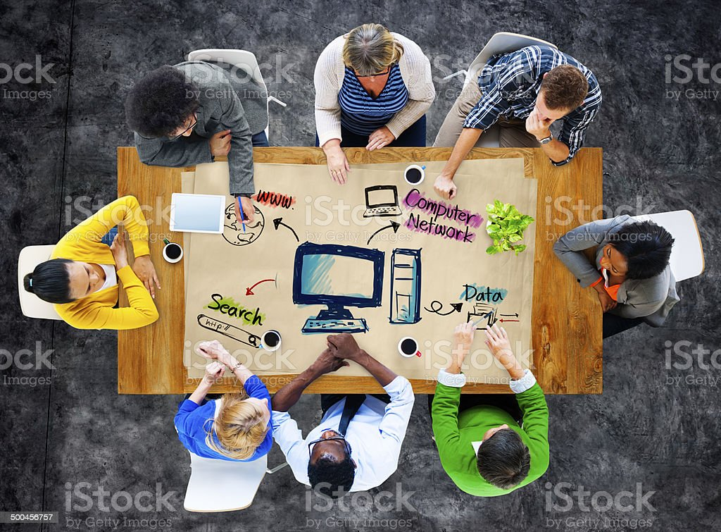 Group of people around computer network diagram stock photo