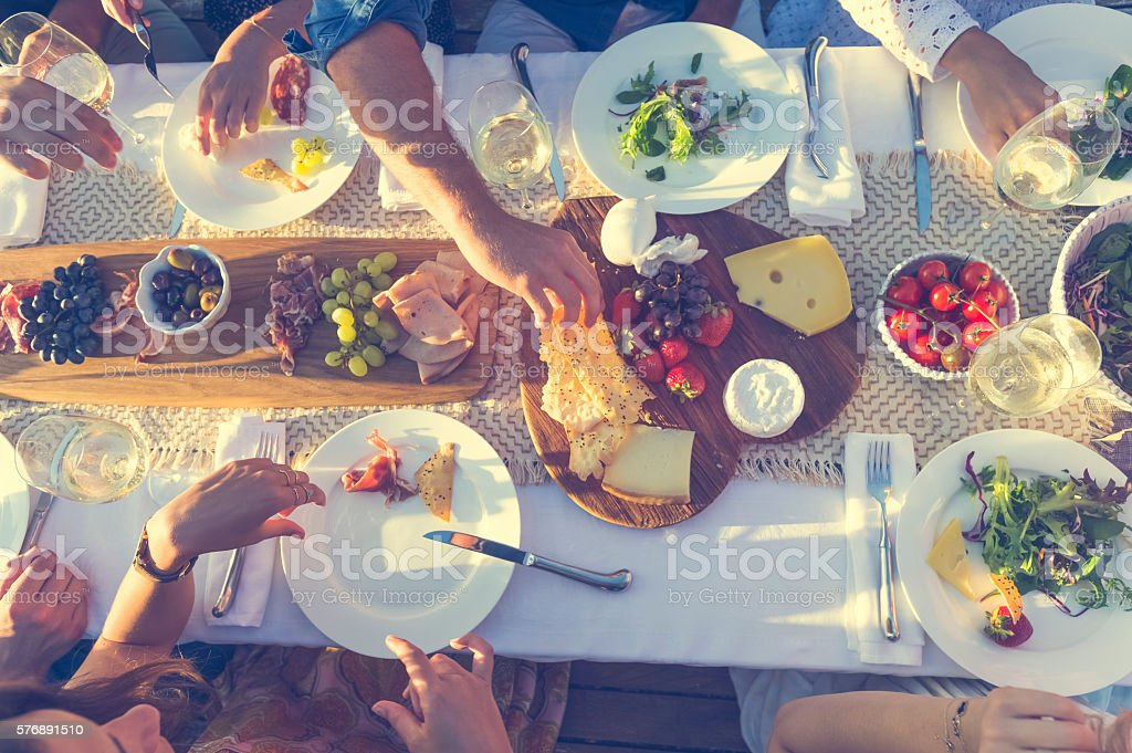 Group of people at a dinner party outdoors. stock photo