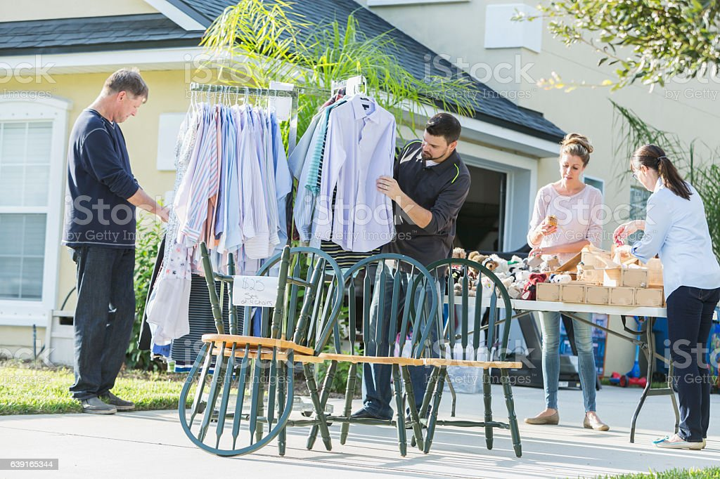 Group of people at a yard sale stock photo