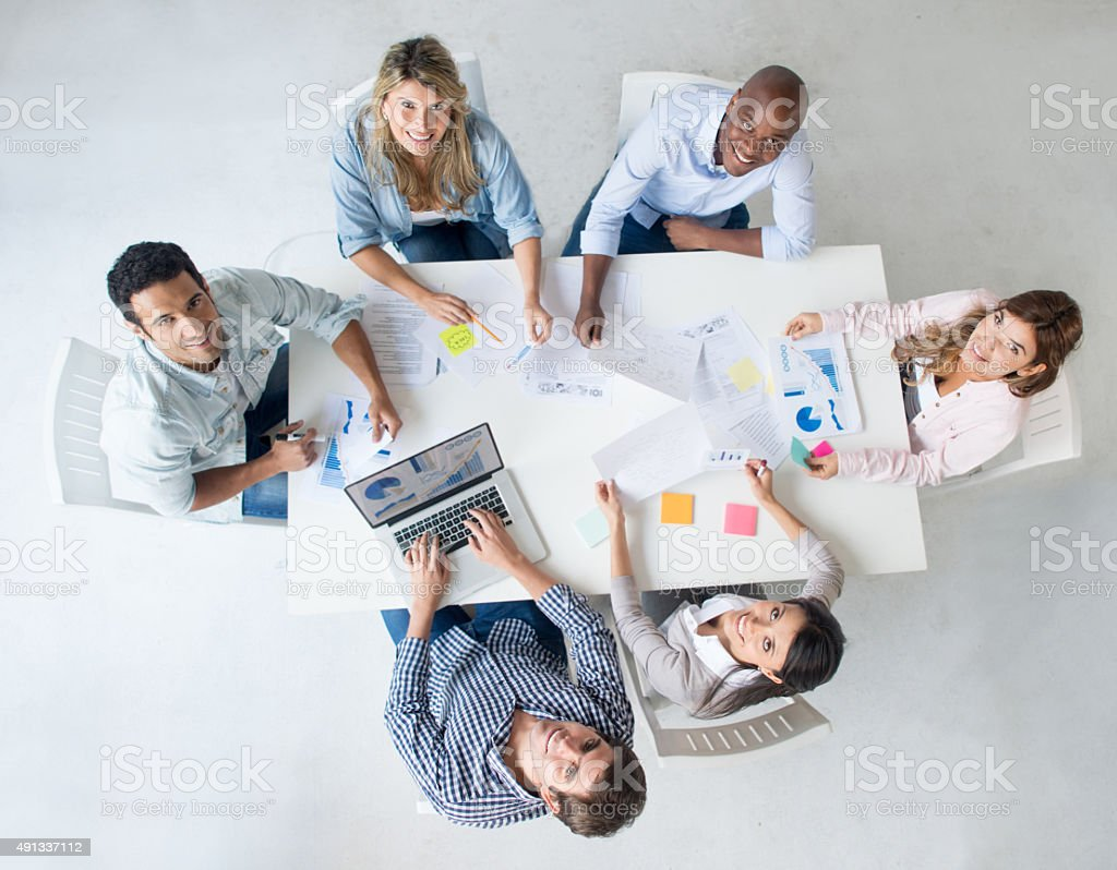 Group of people at business meeting at a creative office stock photo