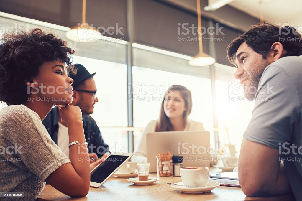 Group of people at coffee shop for startup meeting stock photo