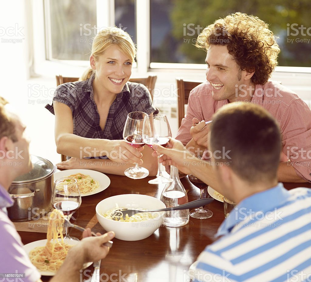 Group of people at home toasting with wine glasses royalty-free stock photo