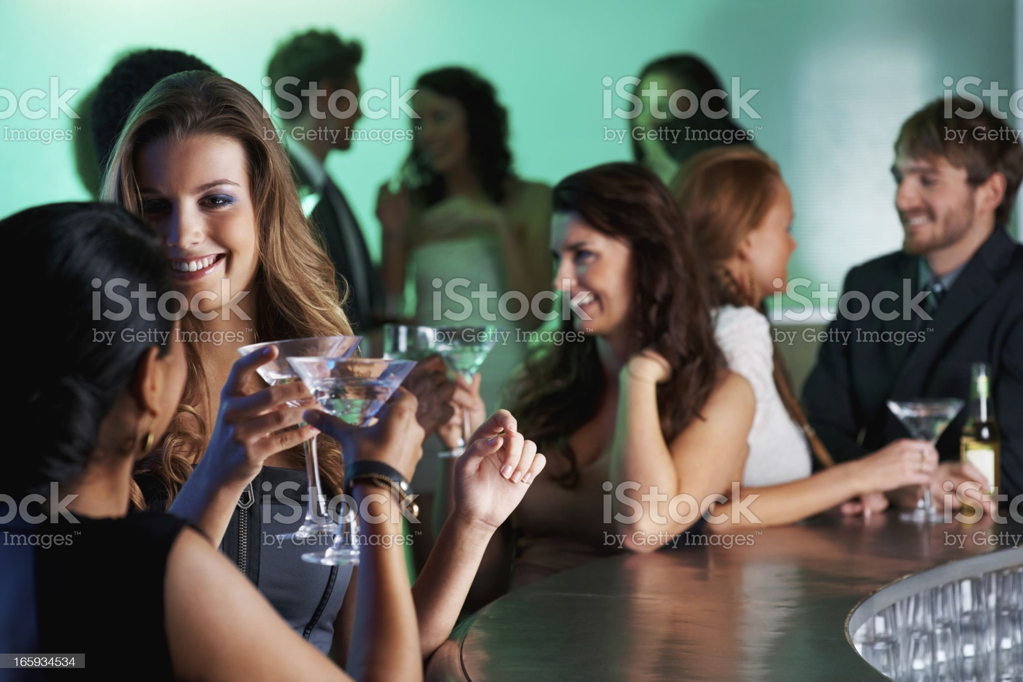 Group of people at party in social club royalty-free stock photo