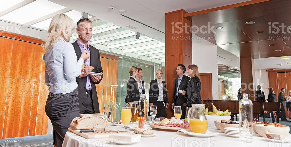 Group of people at seminar having buffet lunch stock photo