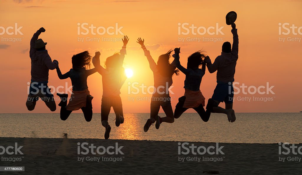 Group of People Celebrating on the beach stock photo