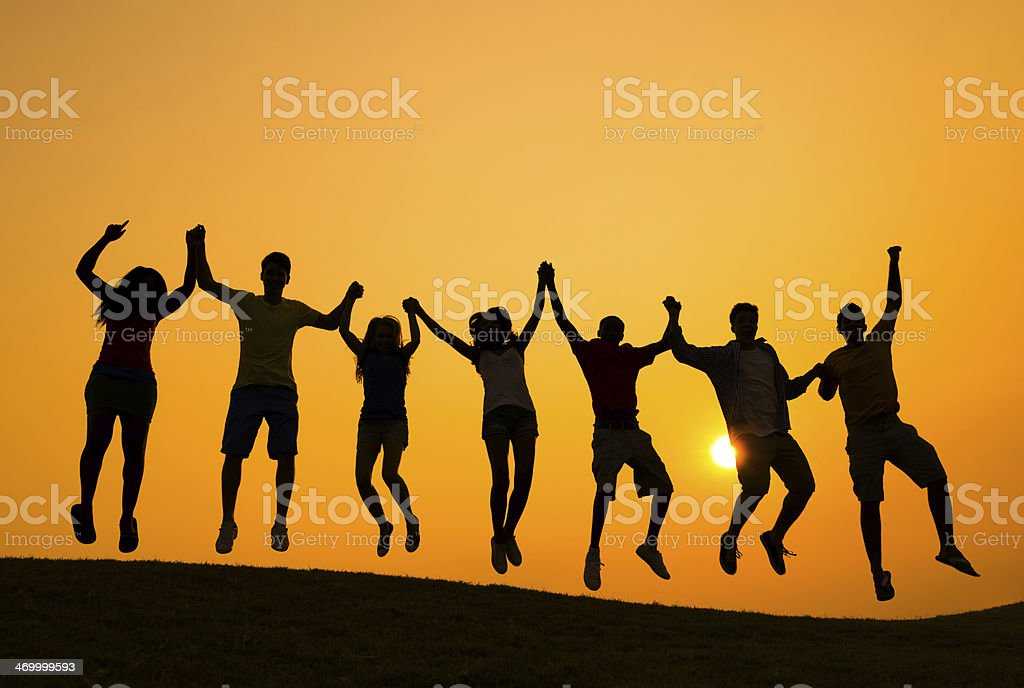 Group of People Celebrating on the Hill stock photo