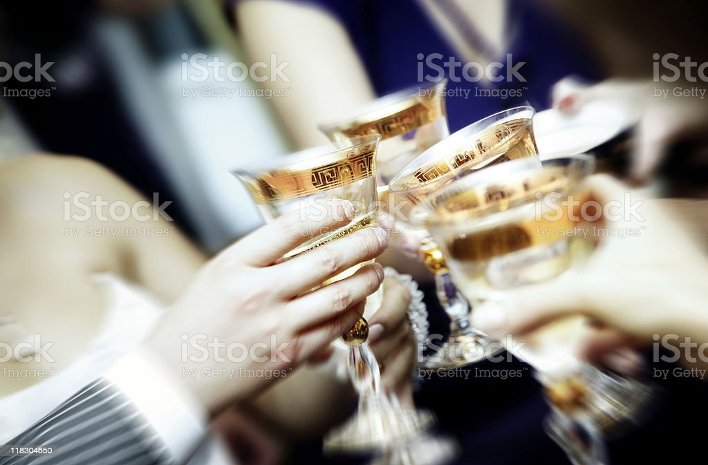 A group of people celebrating with drinks royalty-free stock photo