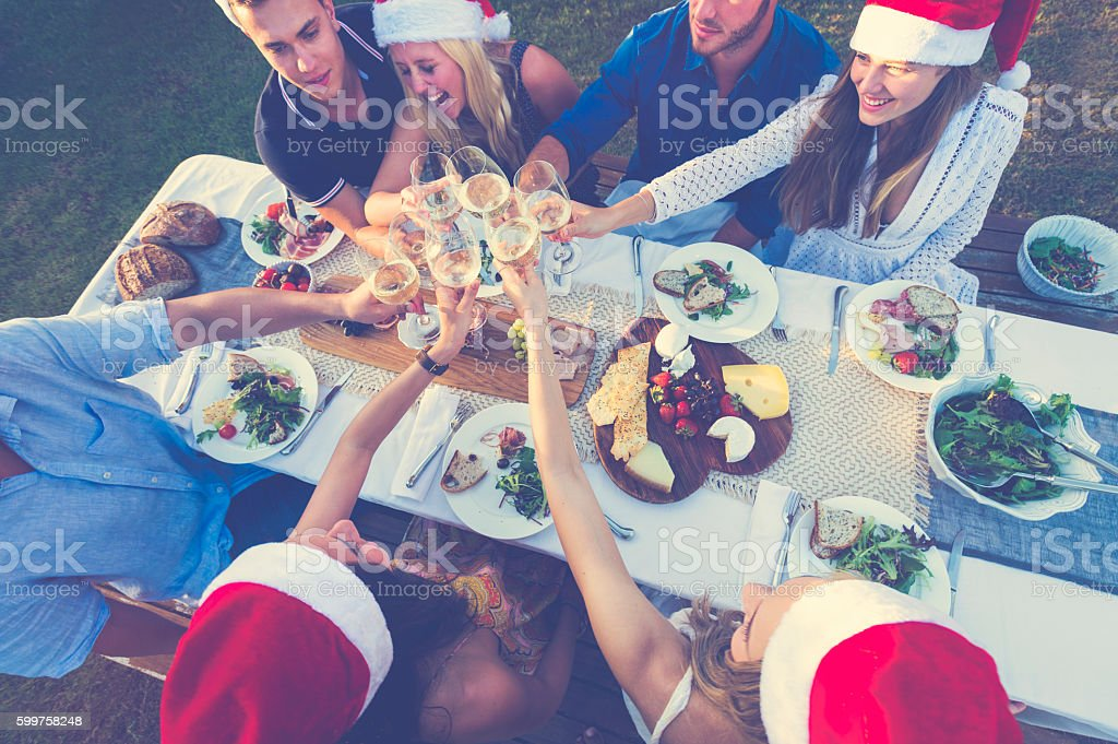 Group of people celebrating with Santa hats. stock photo