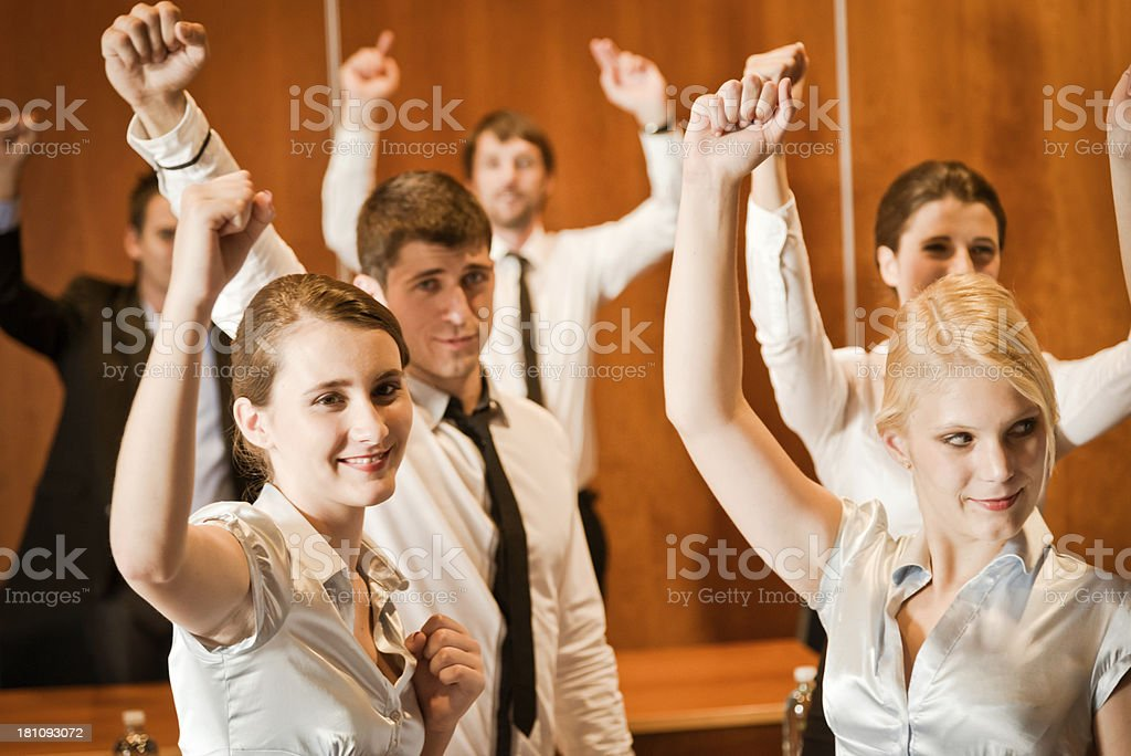 group of people cheering at a conference royalty-free stock photo