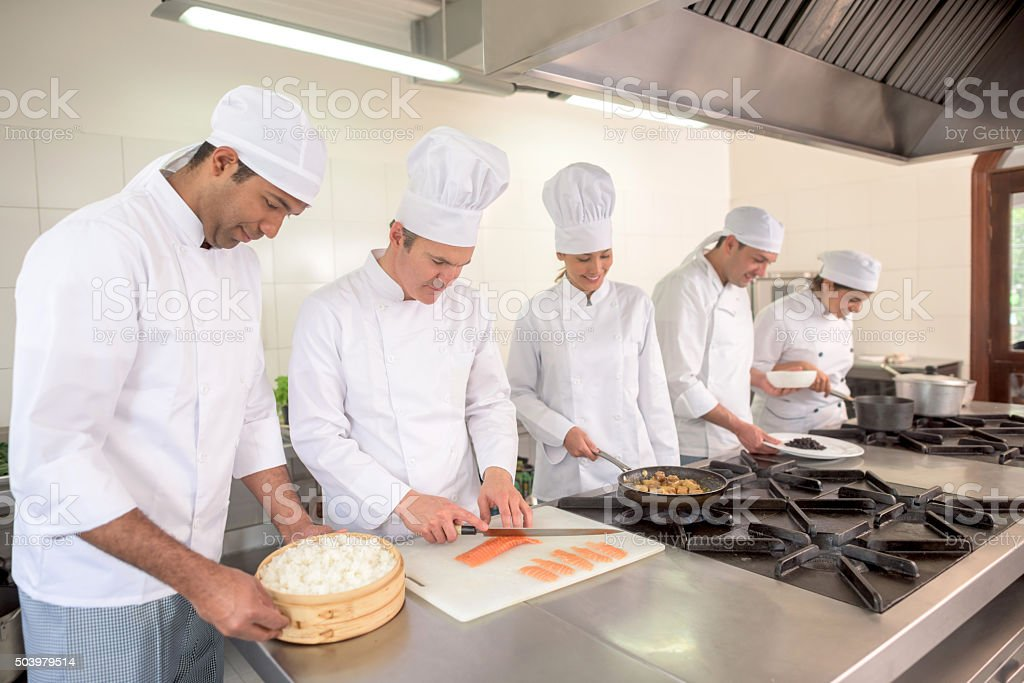 Group of people cooking at a restaurant stock photo