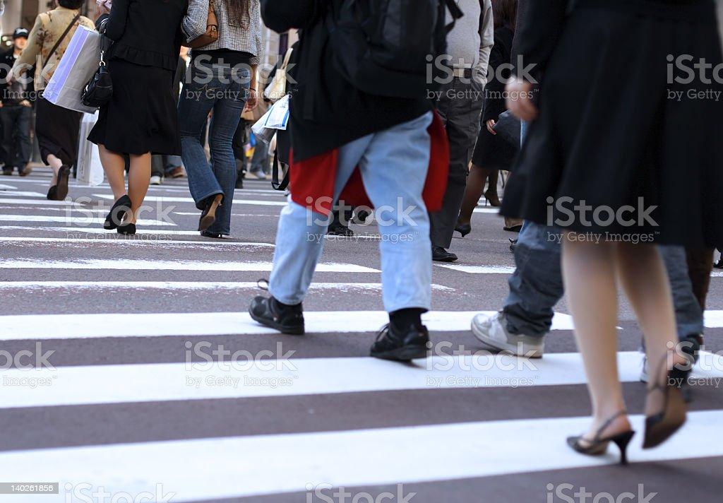 Group of people crossing zebra street royalty-free stock photo