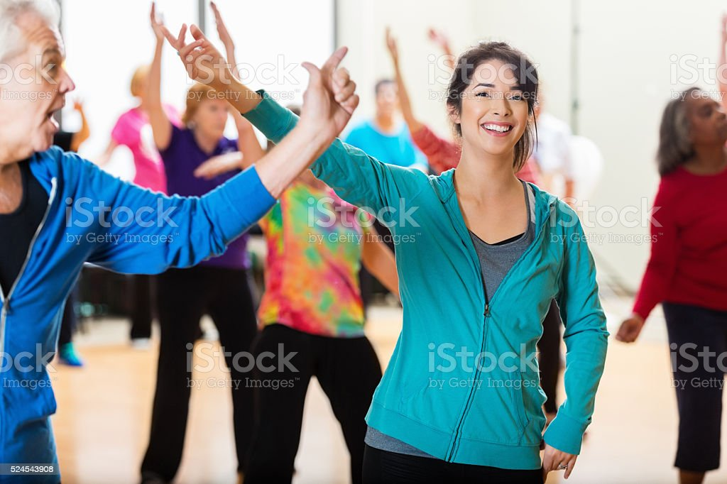 Group of people dancing in exercise class stock photo