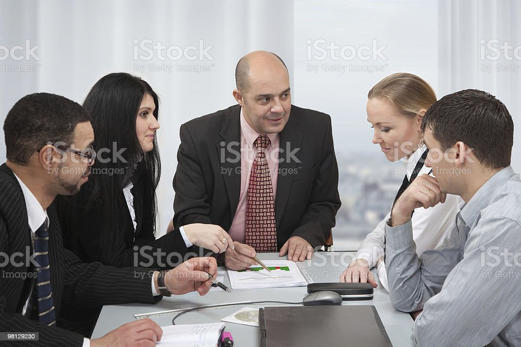 Group of people discussing at the table stock photo