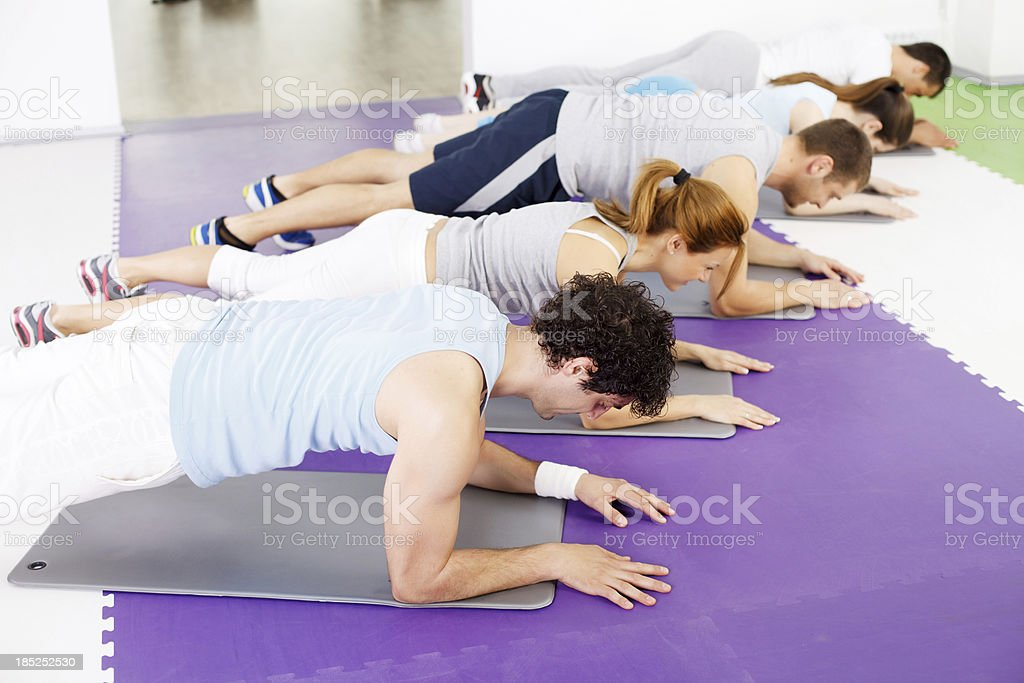 Group of people doing abdominal exercise in the gym. royalty-free stock photo