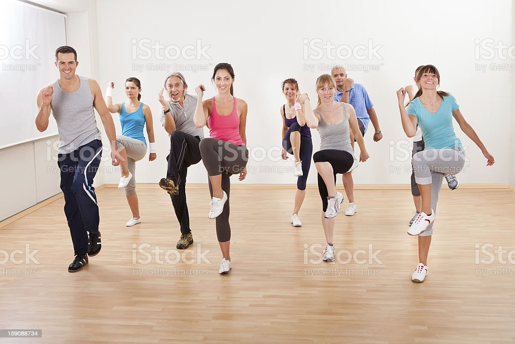 Group of people doing aerobics exercises stock photo