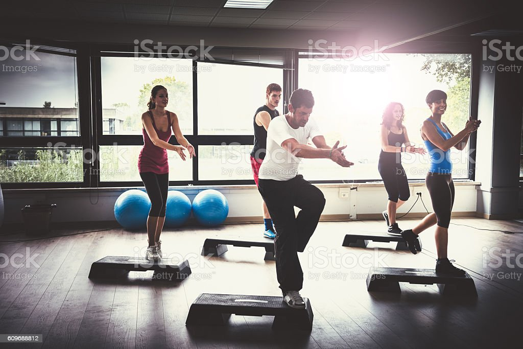 Group of people doing aerobics in the gym stock photo
