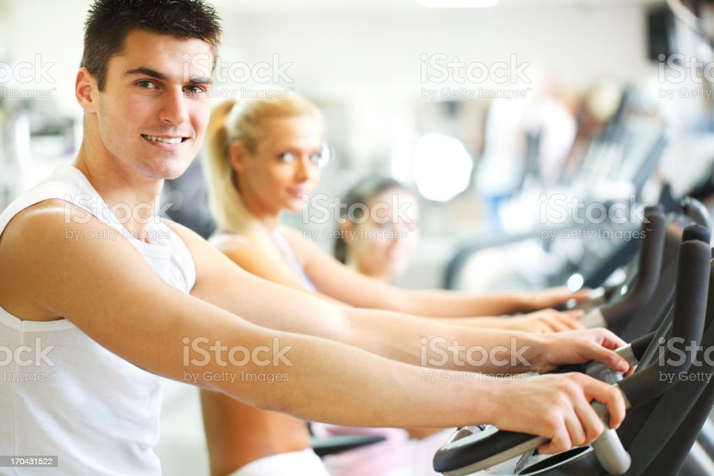 Group of people doing spinning in a modern gym. royalty-free stock photo