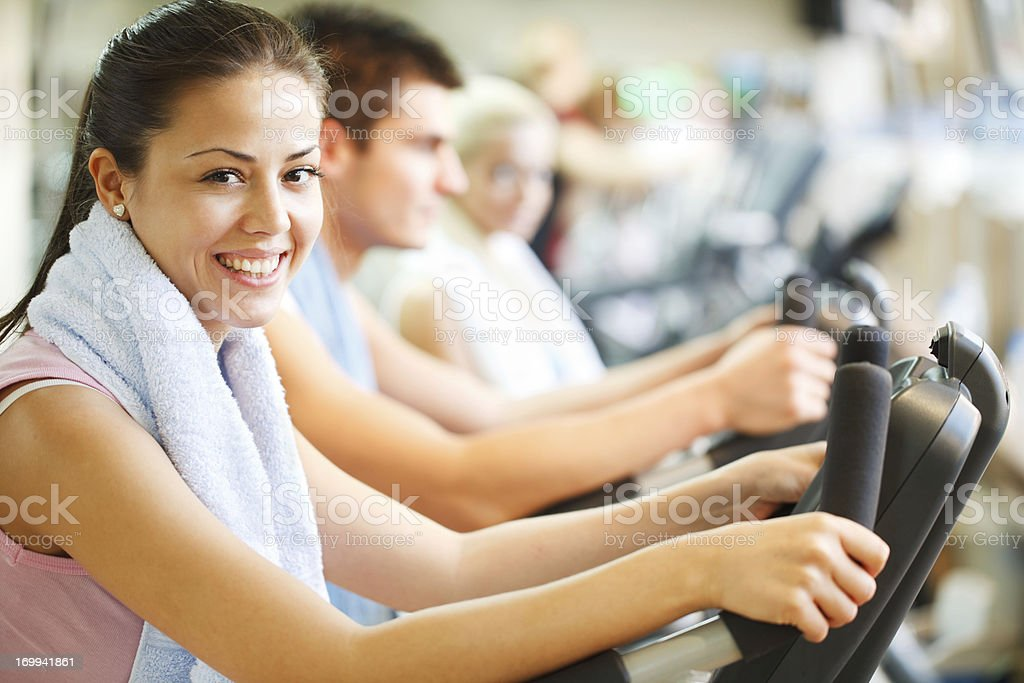 Group of people doing spinning in modern gym. stock photo